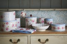 There's something about Rose and Bee that makes us think of traditional teatimes, with fat scones, light-as-air Victoria sponges, and chocolate eclairs filled with cream – and it just so happens that these tins would be perfect to keep them in.