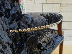 Upholstery nails individually placed. By Kirsty Lockwood Furnishings