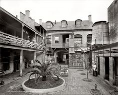 """New Orleans, Louisiana, circa 1906. """"Old French courtyard on Royal Street."""" 8x10 inch dry plate glass negative, Detroit Publishing Company"""