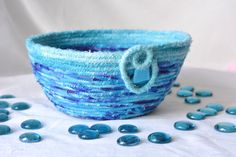 I handmade this pretty Turquoise Coiled Fabric Basket ,,,,,, Handmade by me.... Lovely Aqua and Purple Fiber Yarn Bowl by WexfordTreasures