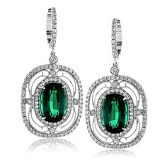 These exquisite vintage-inspired 18k white gold earrings contain delicate filigree and 1.12 ctw of white diamonds surrounding a gorgeous 7.12 ctw of green tourmaline.