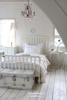 Small neat bedroom with shabby chique detail