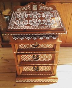 Stencilled drawers white on wood