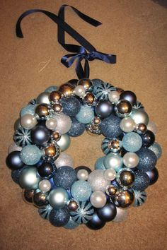 My home made Ornament Wreath.  You need... Ornaments, Foam Wreath, Ribbon, Hot glue gun