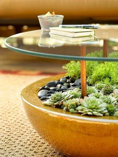 Outdoor Lounge: Table Talk Structure a nifty table by sinking rubber-tipped copper pipe into a large, rock-filled planter holding succulents or plants that dont need a lot of water. Place at least four of the pipes at equal distances apart within the planter. Use weatherproof adhesive that works with glass and metal to secure a glass tabletop to the rubber pipes.