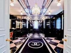 A closet with a Chanel rug...HELL YEAH!!