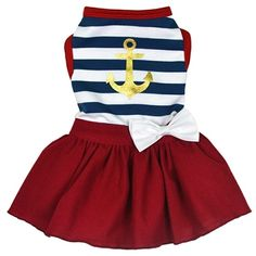 A nautical dress for small dogs with glitter anchor and white bow details.