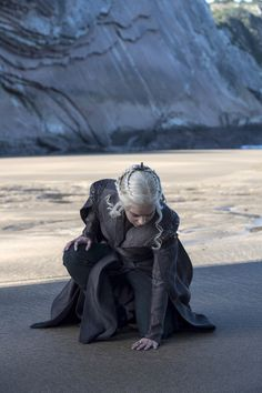 Daenerys Targaryen (Emilia Clarke) touches the soil of the land she's ready to conquer.