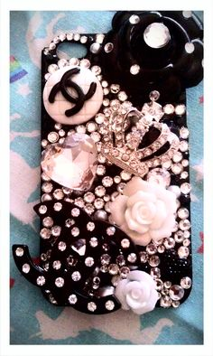http://www.etsy.com/shop/WhimsyandLola   Custom Rhinestone Bling Decoden Phone Portfolio (with coupon code for 50% off next order). $45.00, via Etsy.