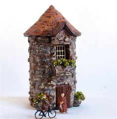 I love this polymer miniature house. Note the little tiny monks out front!