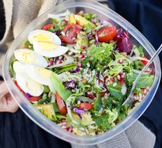 Brown Rice & Pomegranate Salad  Serves two persons    ---3 handfuls mixed baby leaf salad (rinsed)  -2 small leaves green kale (chopped)  -1 cup brown rice (cooked and mixed with olive oil and chopped parsley)  -1/2 fennel (sliced)  -1/2 cucumber (chopped)  -4 small plum tomatoes (sliced)  -2 avocados (chopped)  -2 carrots (sliced)  -1 pomegranate (seeds)  -1/2 bag trail mix (seeds, nuts and dried fruit)    -2 eggs (hard boiled)  -4 tbsp peanut butter    --Put salad and kale in the bottom of…