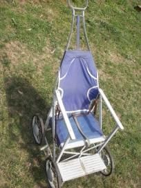 Vintage 50's Columbia Tuk-A-way stroller for Display