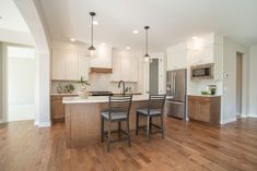 Maple floors, stained and painted cabinets, drywall hood with stained detail Oakland Hills, Maple Floors, Drywall, New Homes For Sale, Painting Cabinets, Condominium, How To Take Photos, Flooring, Detail