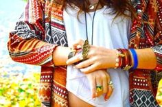 native print sweater and multiple bracelets