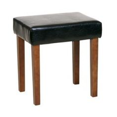 Corona Stool In Black Faux Leather, Light Wood Leg Corona Black Faux Leather Light Wooden Stool Complete with light hardwood legs and upholstered faux leather seat, this stool would look beautiful as seating for any wooden Brown Dressing Tables, Black Stool, Dressing Table With Stool, How To Dress A Bed, Storage Stool, Upholstered Stool, Round Stool, Leather Stool, Wooden Stools
