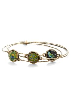 Prized Plume Bracelet. While a little black dress surely cant be beat, its the accessories that really make for the perfect look. #green #modcloth