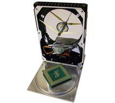 CPU Accented Hard Drive Clock   COOLSHITiBUY.COM