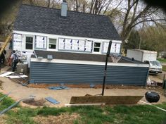 The Elite Exteriors crew after a job well done! The siding ...