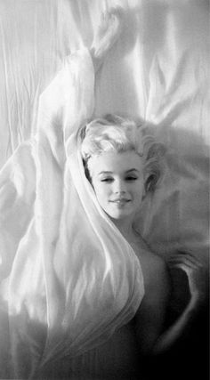 'The Marilyn' - iconic shot of Marilyn in bed with white sheets, creating that sensual sleepy head look.