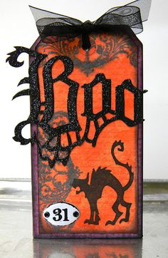 "Tim Holtz inspired ""Boo"" Halloween tag.  Let me just say Shelly Hickox @ Stamptramp is beyond amazing!  Her creations are nothing but fantastic inspiration! LOVE her stuff!"