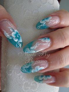 Teal tropical flower nail art.