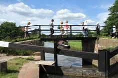 Photo of walkers crossing St Catherine's Lock on the River Wey during the Wey & Arun Canal Trust 2014 Poddle (sponsored walk). 153 walkers took part and the Poddle raised at least £9000. Further details at www.weyandarun.co.uk/latestnews.php?id=40