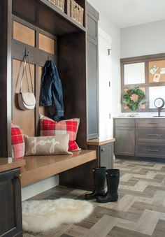 We loved this beautiful mudroom with it's warm wood cabinets and herringbone tile floors, but we made it even better by styling it with 4 different looks!