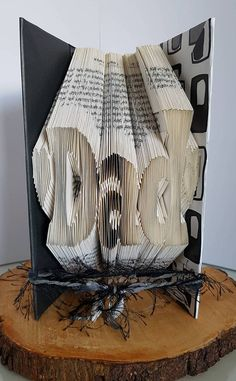 Check out this item in my Etsy shop https://www.etsy.com/uk/listing/272545302/folded-book-art-dad-hearts-unique