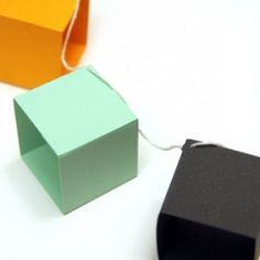 Make these out of simple colored construction paper :) take hole punch and punch hole in the top and pop the christmas light through it. instead of using string.