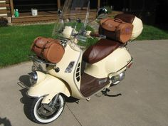 freaking cute. this one is a vespa but there is a similar Znen for 1200. I love the bags this person is using