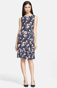 Zandi' Flower Print Jersey Crepe A-Line Dress: The knot detail accentuates your waist, and then drapes easily around the hips. This dress is not meant to be fitted, the light jersey fabric will move easily around you.