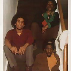 Bob Marley.  Bunny on the bottom step. Not sure if that's Peter on the top stair.  This is a rare photo.