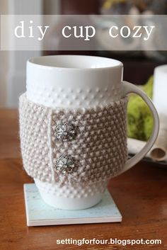 DIY Cup Cozy Tutorial from Setting for Four, made with Lion Brand Vanna's Choice. Vintage buttons make this a beautiful and fast-finish gift idea.