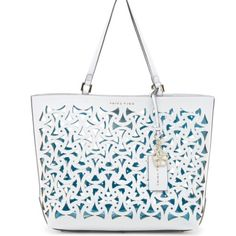 Trina Turk Lasercut White Tote This summer's must-have! A go-anywhere tote with trendy lasercut floral details. The bag is made of faux leather and has a clear lining. The double shoulder straps have a 6.5 inch drop. It is 17.25 inches wide, 12 inches high, and 6 inches deep. The top has a magnetic closure. It comes with the dust bag. Trina Turk Bags Totes