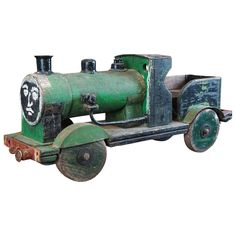 Green Painted Toy Train | From a unique collection of antique and modern toys at https://www.1stdibs.com/furniture/more-furniture-collectibles/toys/