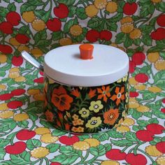 Retro Sugar Bowl with Lid and Spoon  Very pretty floral design. Mix of black, white, yellow, orange, and green. In AMAZING condition!