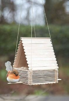 11 Colorful Bird Feeders You Can DIY - diy kids crafts Popsicle Stick Art, Popsicle Stick Crafts For Kids, Craft Stick Crafts, Kids Crafts, Popsicle Stick Birdhouse, Lolly Stick Craft, Craft Stick Projects, Ice Cream Stick Craft, Craft Sticks