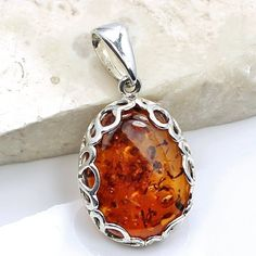 'Golden Sunset' Sterling Silver Natural Baltic Amber Pendant  Price : $59.95 http://www.silverplazajewelry.com/Golden-Sterling-Silver-Natural-Pendant/dp/B00GTQALW6