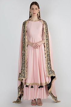 RANIAN Featuring a blush pink anarkali kurta in blended silk base with golden border. It is paired with matching sharara pants and dupatta having zardozi and gota embroidery.