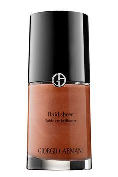 Highlighting Tips For Women Of Color #refinery29  http://www.refinery29.com/highlighters-makeup-for-dark-skin#slide-3  Barose — along with many other beauty pros — loves Armani Fluid Sheer liquid highlighters because they come in a range of different shades. For dark skin, he advises picking up gold (14) or copper (18) and buffing it onto the skin with a Beautyblender....