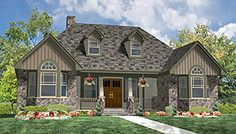 This 1.5 story Cottage features 1793 sq feet. Call us at 866-214-2242 to talk to a House Plan Specialist about your future dream home!