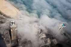 buildings through the clouds