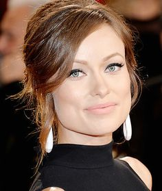 Olivia Wilde: Makeup artist Melanie Inglessis created a '60s-inpired look on Wilde with Revlon's ColorStay Liquid Liner ($7) in Blackest Black and the brand's Super Lustrous Lipstick ($8) in Pink Cognito at the 86th Annual Academy Awards. #OliviaWilde #Oscars #RedCarpet