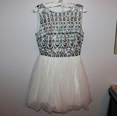 B. Darlin sequined dress Excellent condition. Sequin patterned top with a tutu bottom. The back cuts down into a v and zips. Size is 5/6 B. Darlin Dresses Mini