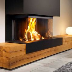 fireplace - black matte and massive natural wood Home Fireplace, Modern Fireplace, Fireplace Design, Fireplace Mantels, Design Case, Home And Living, Family Room, Sweet Home, New Homes