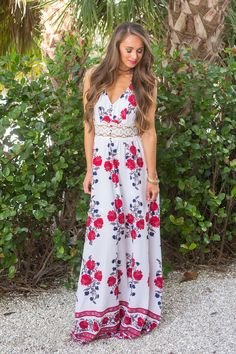 This gorgeous floral maxi is made for days by the beach and nights celebrating friends and family! We love the beautiful floral print in red, white, dark blue, beige, and grey - it's such a classic co