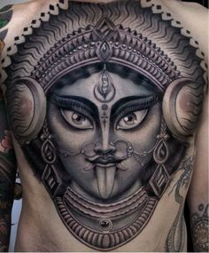 What does kali tattoo mean? We have kali tattoo ideas, designs, symbolism and we explain the meaning behind the tattoo. Kali Chest Tattoo, Kali Tattoo, God Tattoos, Body Art Tattoos, Tattoos For Guys, Tatoos, Hindu Tattoos, Tattoo Espalda, Krishna Tattoo