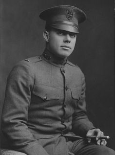 American Officer of Chemical Warfare Service  A first or second lieutenant of the Chemical Warfare Service poses in his M1917 tunic with the CWS insignia on the collar. The peaked cap is the M1905 model with a bronze eagle on the front.  Formerly the U.S. Army Gas Service, the Chemical Warfare Service contained the Pyrotechnic Section, which experimented with Livens projectors and flamethrowers. Cop Uniform, Men In Uniform, Second Lieutenant, Gas Service, Peaked Cap, War Photography, World War One, British Army, Us Army