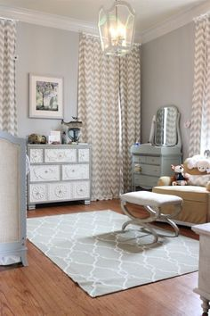 Grey doesn't have to be drab. This cool-toned nursery uses a metallic hue to evoke princess-like elegance, echoed by a royally precious light fixture and vanity to match. Via Eclectic Home