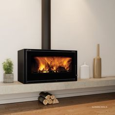 Chama Stoves Cristal 88 Stove Cristal 88 Stove - Dimensions: 890 (a) (b) (C) -Fan - Power: 15 kw - Efficiency: - Diameter flue: - Energy . Stove Fireplace, Fireplace Wall, Living Room With Fireplace, Fireplace Design, Modern Wood Burning Stoves, Wood Stoves, Wood Fuel, Freestanding Fireplace, Log Burner